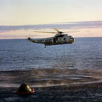 A member of the Apollo 10 crew is hoisted into a helicopter from the prime recovery ship, USS Princeton.jpg