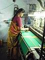A woman handling power loom.JPG