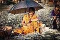 A women selling vegitables in harsh sunlight.jpg