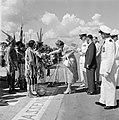 Aankomst van koningin en prins op het vliegveld Zanderij. Begroeting door indian, Bestanddeelnr 252-4193.jpg