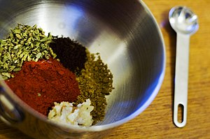 Seasoning - The ingredients for achiote paste: ground annatto, oregano, ground cumin and ground cloves