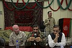 Afghan National Army Maj. Gen. Sayed Malook, center left, the commanding general of the 215th Corps, speaks during a friendship dinner at the Afghan Cultural Center at Camp Leatherneck in Helmand province 130725-M-RF397-292.jpg