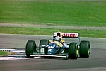 Alain Prost - Williams FW15C during practice for the 1993 British Grand Prix (33557472711).jpg