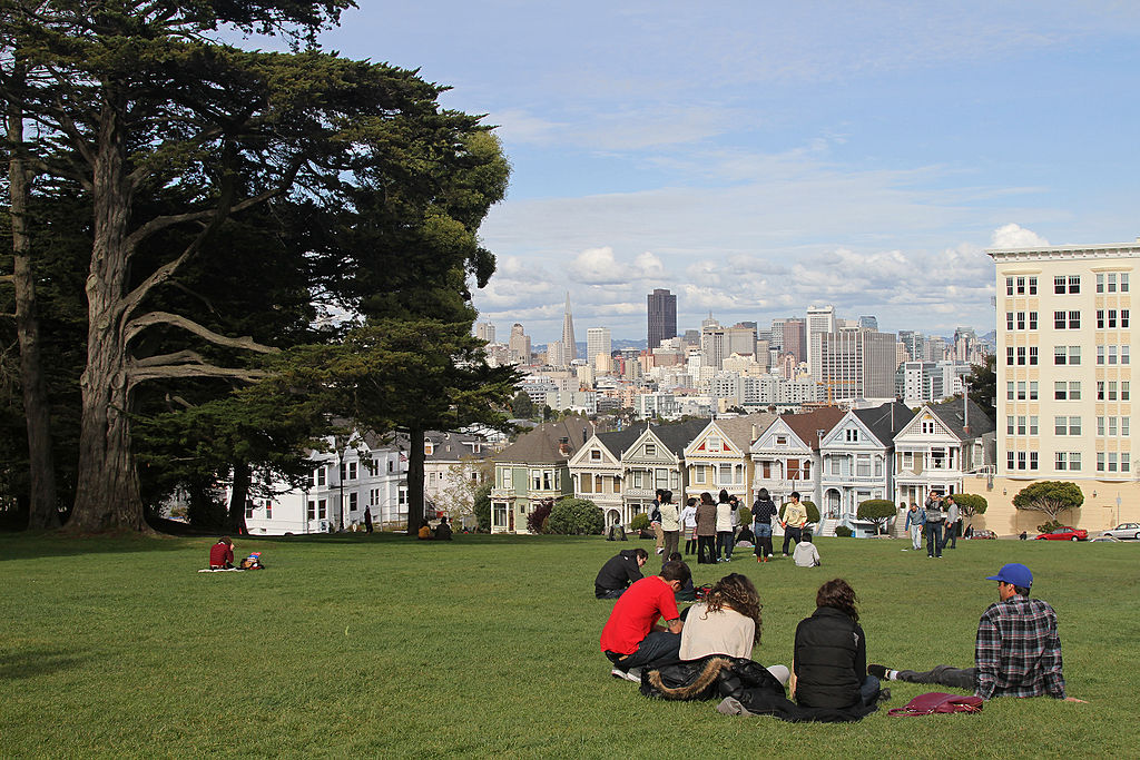 """Looking across Alamo Square Park towards the famous """"Painted Ladies"""" and city skyline"""