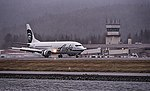 Alaska Airlines passing the Tower (30772245682).jpg