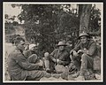 Allied soldiers, one with a bandaged head, sitting on the ground during World War I LCCN2017645503.jpg
