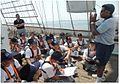 An Indian Navy Rigging Officer gives safety instructions to Royal Singapore Navy under-trainee officers.jpg