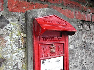 Wall box - This rare Victorian 2nd National standard wall box near Andover in Hampshire has a large hood and a pedimented top to keep the rain out