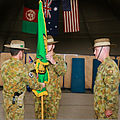 Australian Army Col. Simon Stuart, left, passes the Combined Team Uruzgan flag to Maj. Gen. Gus McLachlan, center, the deputy chief of staff for plans of the International Security Assistance Force Joint 130807-O-MD709-120-AU.jpg