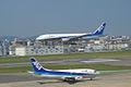 B777-281 touch down to Fukuoka Airport RWY 16 (233648499).jpg