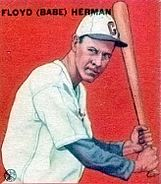 A baseball-card image of a man wearing a white baseball uniform and holding a baseball bat