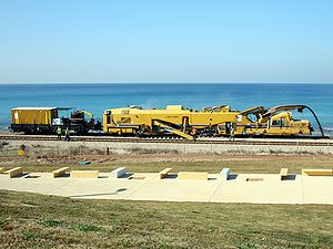 Ballast cleaner - A ballast cleaner in action on the Coastal Railway in Haifa, Israel.