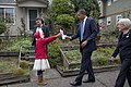 Barack Obama accepts a bouquet from Mieraye Redmond in Seattle.jpg