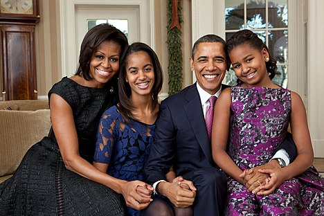 Official portrait by Pete Souza of the Obama family in the Oval Office, December 11, 2011. Barack Obama family portrait 2011.jpg