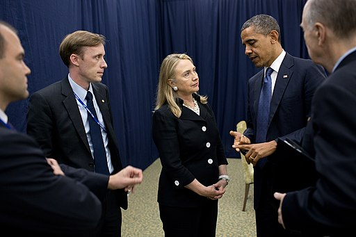Barack Obama talking to Hillary Clinton in Phnom Penh