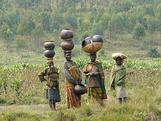 History of Rwanda - Twa women with traditional pottery.