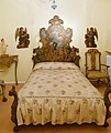Bed with painting of St Augustine, mid 18th century, painted and gilded stucco and pine - Museo Nacional de Artes Decorativas - Madrid, Spain - DSC08291.JPG