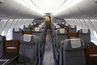 Business Class in a 2-2 layout on the upper deck of a Boeing 747-8I. Business Class on all of the airline's other wide-body aircraft has a 2-2-2 layout. Boeing 747-830, Lufthansa AN2119980.jpg