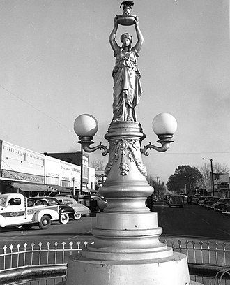 Economic entomology - Boll Weevil Monument, erected by the citizens of Enterprise, Alabama  to honour the pest that ended their dependence on cotton, a poverty crop