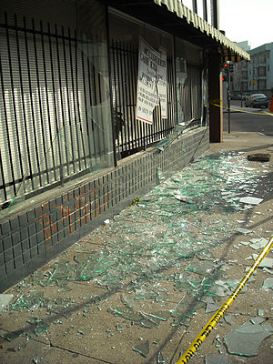 Lots of broken glass on the sidewalk after the...