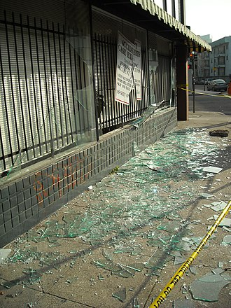 Lakeside Apartments District, Oakland, California - During hours of the unrest and rioting, shops and cars were heavily vandalized such as this one on Harrison Street.  In the background is an apartment building that faces Alice Street.