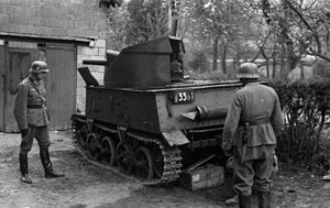 Belgian combat vehicles of World War II - Two German soldiers looking at a captured T13 B3