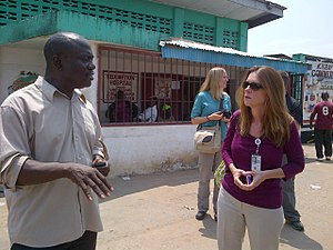 Ebola virus epidemic in Liberia - A CDC official consulting with a Liberian District representative about Ebola