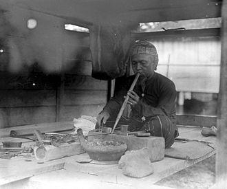 Goldsmith - A Karo people (Indonesia) goldsmith in Sumatra (circa 1918)