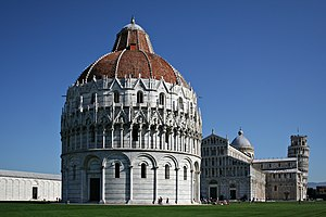 The Piazza dei Miracoli. The Baptistery is in the foreground, the Duomo is in the center, and the leaning tower in the background on the right.