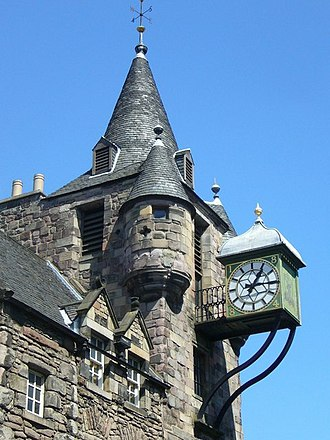 Canongate Tolbooth - The clock with bartizans to either side and the conical spire