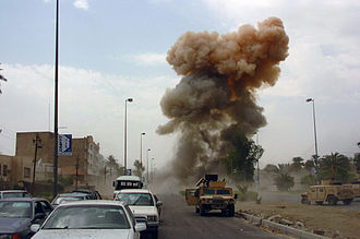 2005 in Iraq - As Coalition Forces arrive at a car bombing in South Baghdad, a second car bomb is detonated, targeting those responding to the initial incident. 14 April 2005