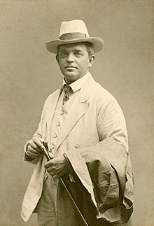 Portrait photograph of a smartly dressed Nielsen