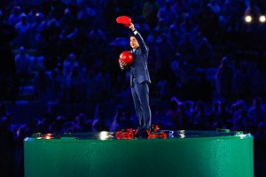 2016 Summer Olympics closing ceremony - Japanese Prime Minister Shinzō Abe standing atop a Warp Pipe while holding Mario's trademark red cap and the red circle from the flag of Japan.
