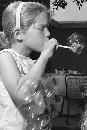 Bubble pipe - Child blowing a bubble pipe, 1962