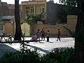 Children playing with water in 17 Shahrivar street rill - Nishapur 3.JPG