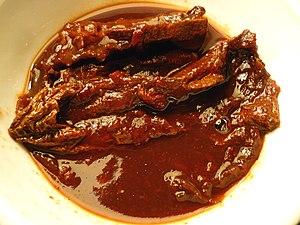 A small bowl of homemade chipotles en adobo. P...
