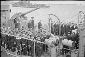 J-, K- and N-class destroyer - Church service aboard HMS Javelin, August 1940. Note the 4-inch QF Mk V anti-aircraft gun at upper left and the depth charges at bottom right