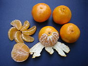 Five Clementines whole, peeled, halved and sectioned.