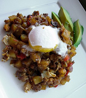 Coddled egg topping Yukon hash