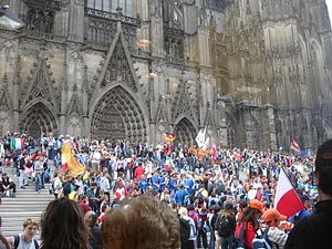 World Youth Day - A view of the celebratory vibe outside the Cologne Cathedral in Germany (2005). The participation of Catholics from many countries worldwide results in an enhanced and collaborate spiritual experience.