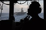 Commanding officer of USS Philippine Sea oversees operations from the bridge wing of the ship. (34955747020).jpg