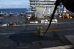 Conducting a fast rope and repelling exercise 120705-N-WW409-121.jpg