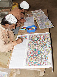 Correctional Activities at Central Jail Faisalabad, Pakistan in 2010 - Convict artists busy in drawing designs of carpets on graph papers.JPG