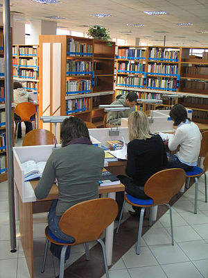 Essay - University students, like these students doing research at a university library, are often assigned essays as a way to get them to analyze what they have read.