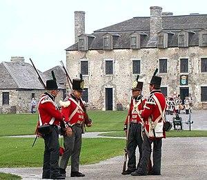 Reenactors dressed in British 1812 uniforms at...