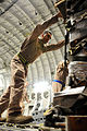 Defense.gov News Photo 100802-F-3610S-193 - U.S. Air Force Staff Sgt. Manuel Chacon pushes a pallet of Halal meals off a C-17 Globemaster III aircraft at the Peshawar International Airport in.jpg