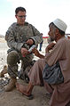 Defense.gov News Photo 100811-A-0230S-115 - A U.S. Army medic left attached to Legion Company 1st Battalion 503rd Infantry 173rd Airborne Brigade Combat Team treats an Afghan flood victim.jpg
