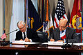 Defense.gov News Photo 110208-D-9880W-099 - Secretary of Defense Robert M. Gates left and French Minister of Defense Alain Juppe right sign a document entitled Space Situational Awareness.jpg