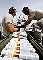 Defense.gov News Photo 110808-F-AU128-142 - U.S. Air Force Senior Airman Adam Hinojosa left and Staff Sgt. Robert Corso right load ammunition into an A-10C Thunderbolt II on Kandahar.jpg