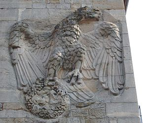 "German Wine Gate - After the war the two headed eagle which had proudly decorated the ""Weintor"" when viewed from France, across the frontier, had its swastika cut away along with one of its two heads."